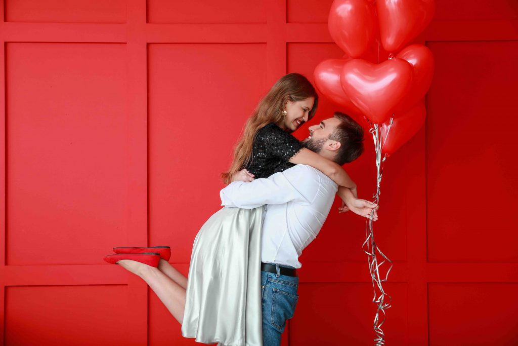 young couple in love, heart shaped balloons, valentine's day