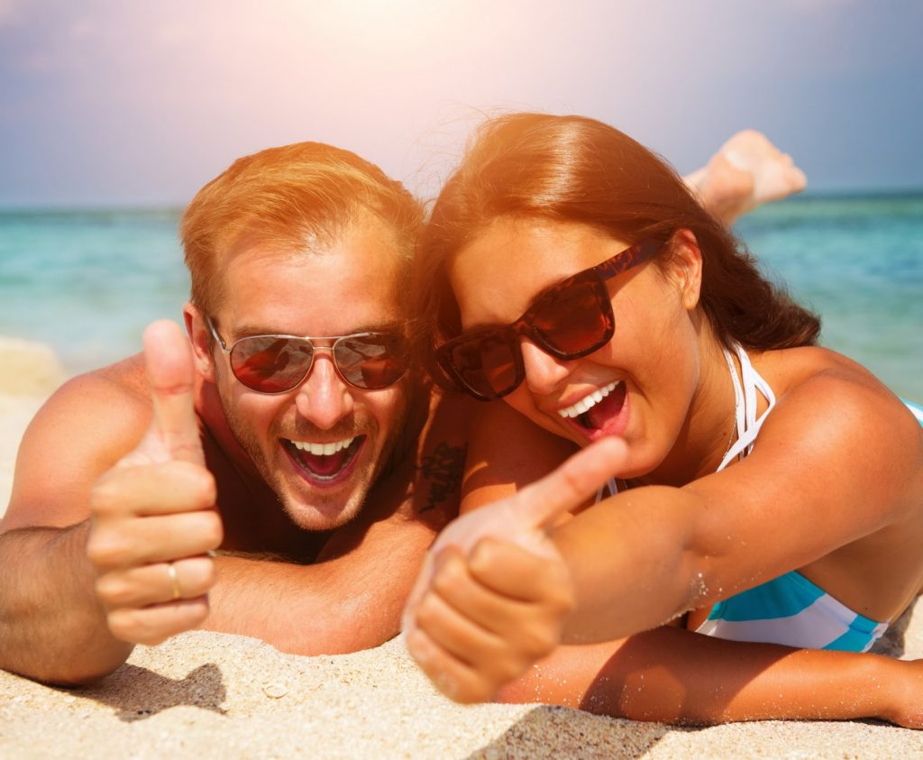 Couple wearing sunglasses at the beach, wearing sunglasses at the beach, Enjoying the beach with sunglasses