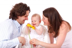 Family with baby, baby holding flower, family with one kid, mother, father, and baby, family photo