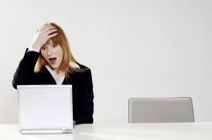 Woman surprised looking at computer, Woman surprised, woman staring at computer