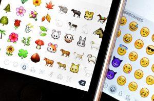 Emojis on a phone, group of emojis on a phone, emoji cluster