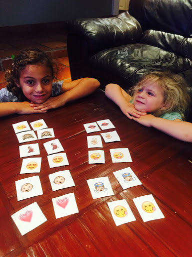 Kids playing emoji cards, emojis on cards, emoji cards, playing with emojis