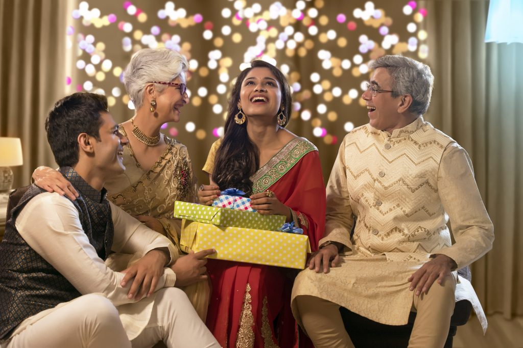 Different generations of Indians giving gifts, Indians of different generations at home
