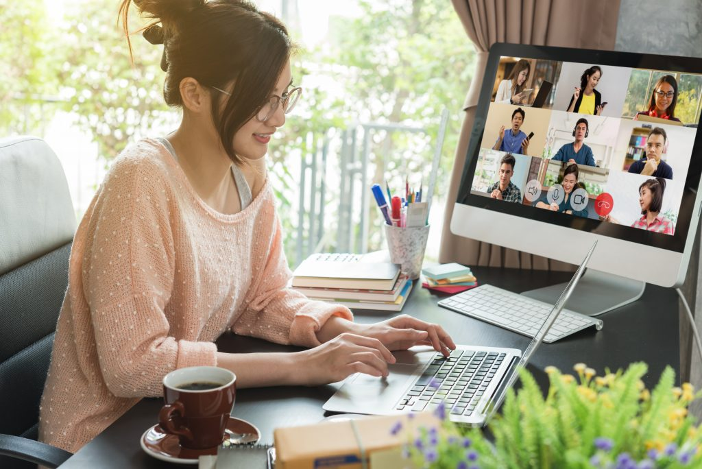 Woman working at home, woman on laptop, woman teleconferencing
