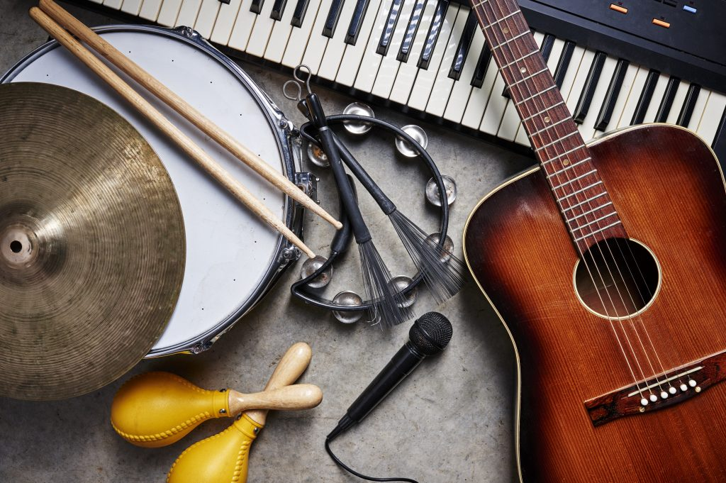 Flat lay of musical instruments, guitar, tambourine, piano, musical instruments flatlay
