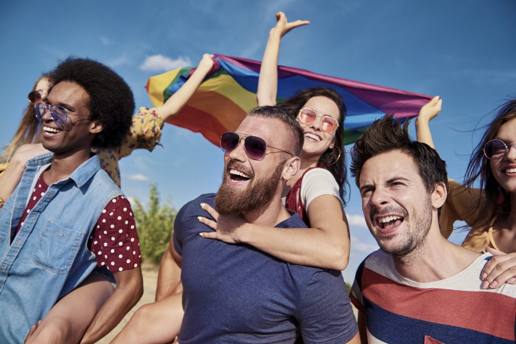 Group of best friends having fun, Rainbow Flag, Rainbow Flag emoji, friends holding a rainbow flag