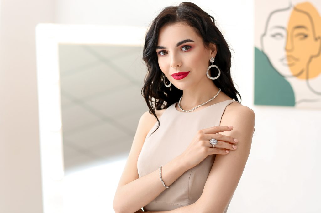 Beautiful young woman wearing stylish jewelry indoors, woman wearing a ring, woman with a ring