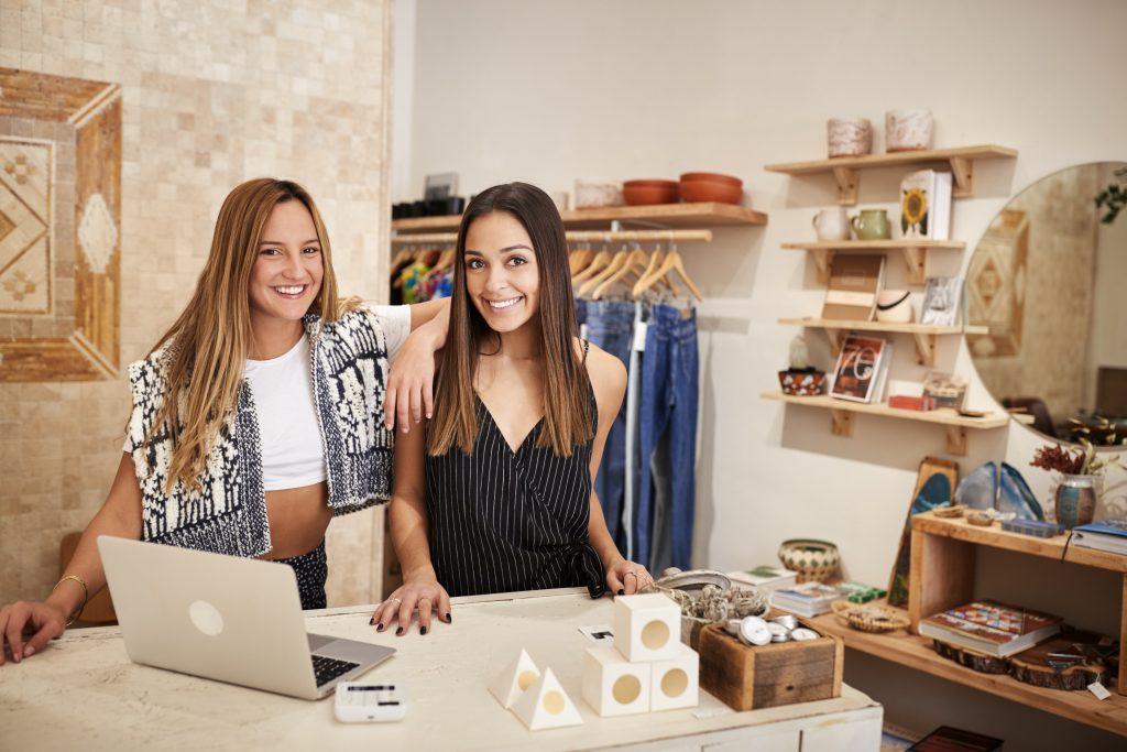 women behind desk at store, women entrepreneurs at store, women business owners
