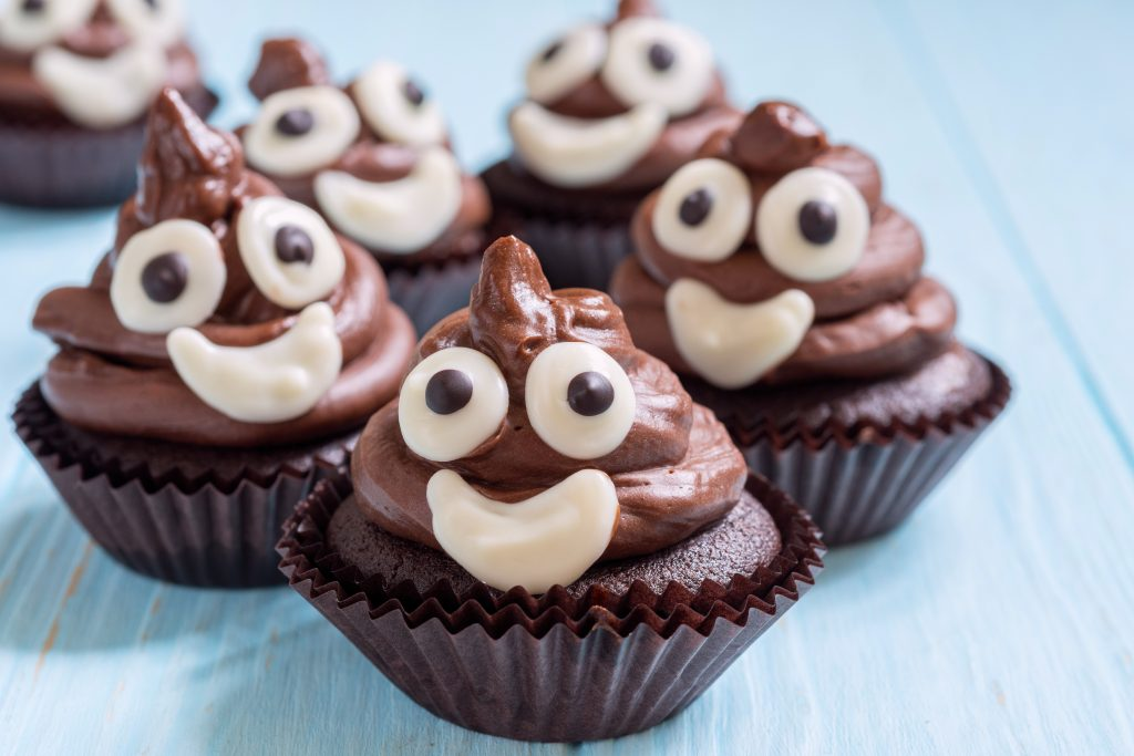 Funny poop emoji chocolate cupcakes. Cute food dessert