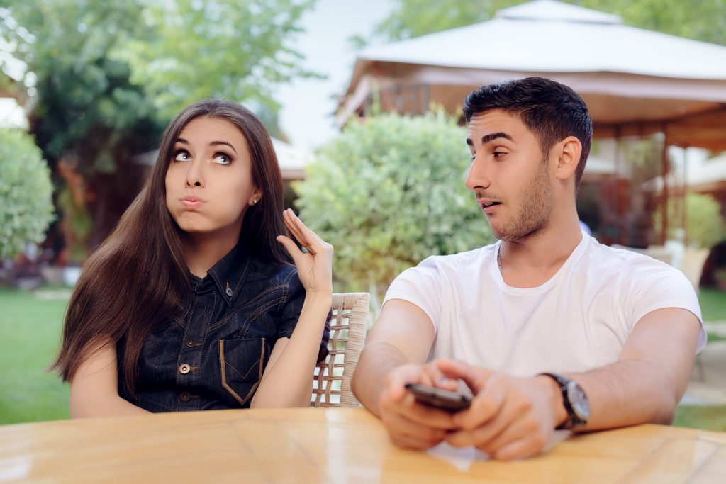 girl rolling eyes at boyfriend, girlfriend and boyfriend at a table, eye rolling, rolling eyes, eye roll