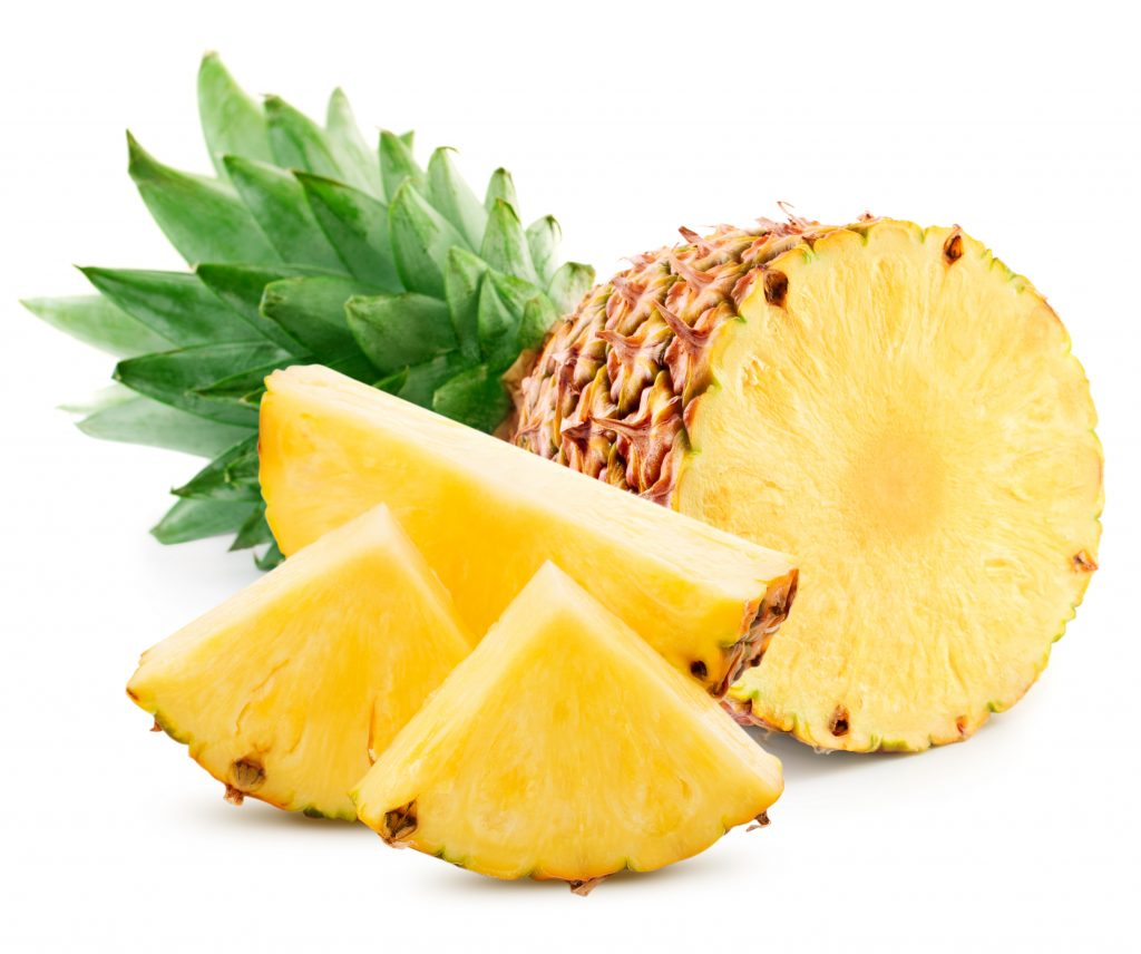 pineapple fruit with slices isolated on white