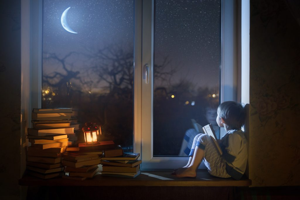 boy gazing at the crescent moon, crescent moon at night, boy looking at the moon