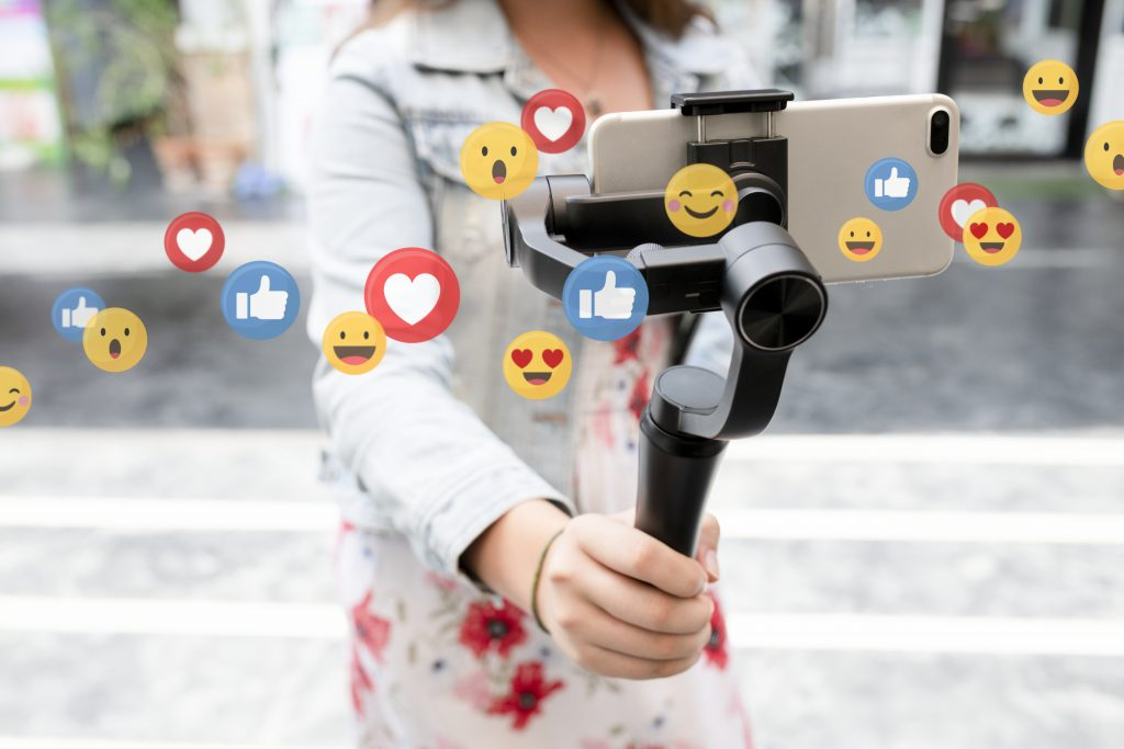 Vlogger recording a video in the street, emojis, vlogging with emojis