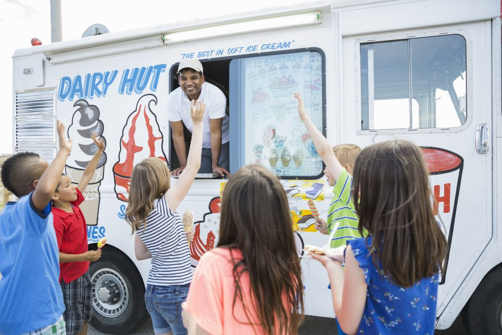 kids outside an ice cream truck, group of kids in front of an ice cream truck