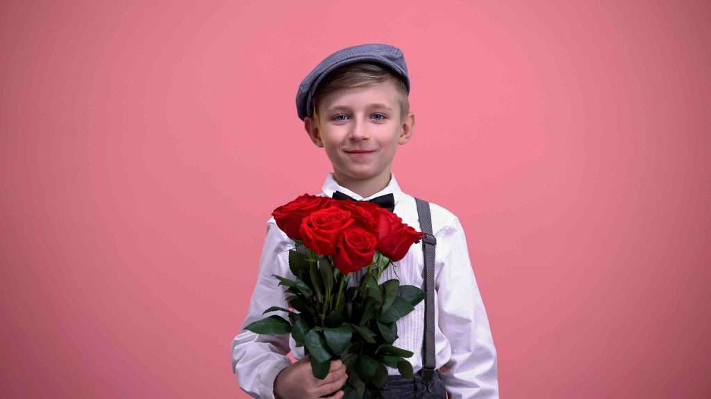 Boy holding a bouquet of roses