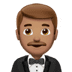 🤵🏽 man in tuxedo: medium skin tone Emoji on Apple Platform