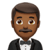 🤵🏾 man in tuxedo: medium-dark skin tone Emoji on Apple Platform