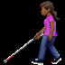 👩🏾‍🦯 woman with probing cane: medium-dark skin tone Emoji on Apple Platform