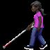 👩🏿🦯 woman with probing cane: dark skin tone Emoji on Apple Platform