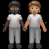 🧑🏿‍🤝‍🧑🏽 people holding hands: dark skin tone, medium skin tone Emoji on Apple Platform