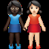 Dark Skin Tone And Light Skin Tone Women Holding Hands