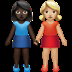 👩🏿‍🤝‍👩🏼 women holding hands: dark skin tone, medium-light skin tone Emoji on Apple Platform