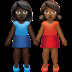 Dark Skin Tone And Medium Dark Skin Tone Women Holding Hands