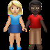 👩🏼‍🤝‍👨🏿 woman and man holding hands: medium-light skin tone, dark skin tone Emoji on Apple Platform