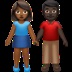 👩🏾‍🤝‍👨🏿 woman and man holding hands: medium-dark skin tone, dark skin tone Emoji on Apple Platform