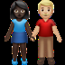 👩🏿‍🤝‍👨🏼 woman and man holding hands: dark skin tone, medium-light skin tone Emoji on Apple Platform