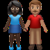 👩🏿‍🤝‍👨🏽 woman and man holding hands: dark skin tone, medium skin tone Emoji on Apple Platform
