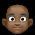 👨🏿🦲 man: dark skin tone, bald Emoji on Facebook Platform