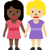 👩🏿‍🤝‍👩🏼 women holding hands: dark skin tone, medium-light skin tone Emoji on Facebook Platform