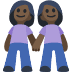 👭🏿 women holding hands: dark skin tone Emoji on Facebook Platform