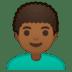 👨🏾🦱 Medium Dark Skin Tone Curly Hair Man Emoji on Google Platform