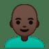 👨🏿🦲 man: dark skin tone, bald Emoji on Google Platform