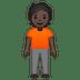 🧍🏿 person standing: dark skin tone Emoji on Google Platform
