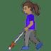 👩🏽🦯 woman with probing cane: medium skin tone Emoji on Google Platform