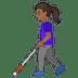 👩🏾🦯 Medium Dark Skin Tone Woman With Probing Cane Emoji on Google Platform