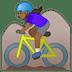 🚵🏾♀️ woman mountain biking: medium-dark skin tone Emoji on Google Platform