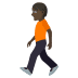 🚶🏿 person walking: dark skin tone Emoji on Joypixels Platform
