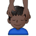 💆🏿‍♂️ man getting massage: dark skin tone Emoji on Samsung Platform