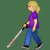 👩🏼🦯 woman with probing cane: medium-light skin tone Emoji on Twitter Platform