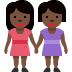 👭🏿 women holding hands: dark skin tone Emoji on Twitter Platform