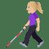 👩🏼🦯 woman with probing cane: medium-light skin tone Emoji on Windows Platform