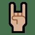 🤘🏼 sign of the horns: medium-light skin tone Emoji on Windows Platform